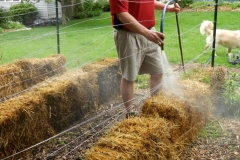This is me (Joel) doing  the conditioning process on the bales early in the spring.